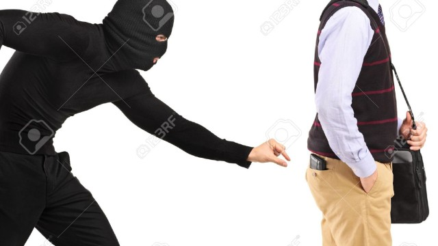 14549662-Pickpocket-trying-to-steal-a-wallet-Stock-Photo-stealing-money-pickpocket